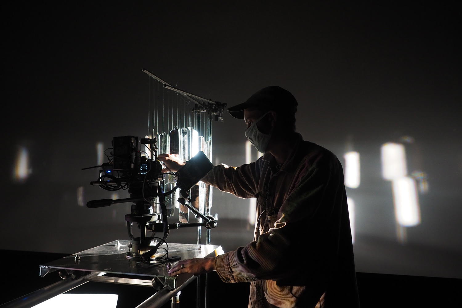 a production technician working with a camera stand