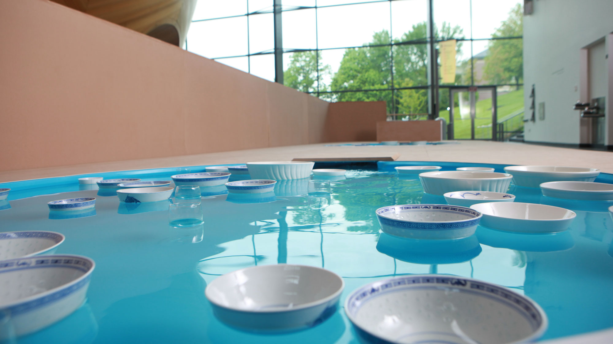 bowls floating in a pool on the mezzanine