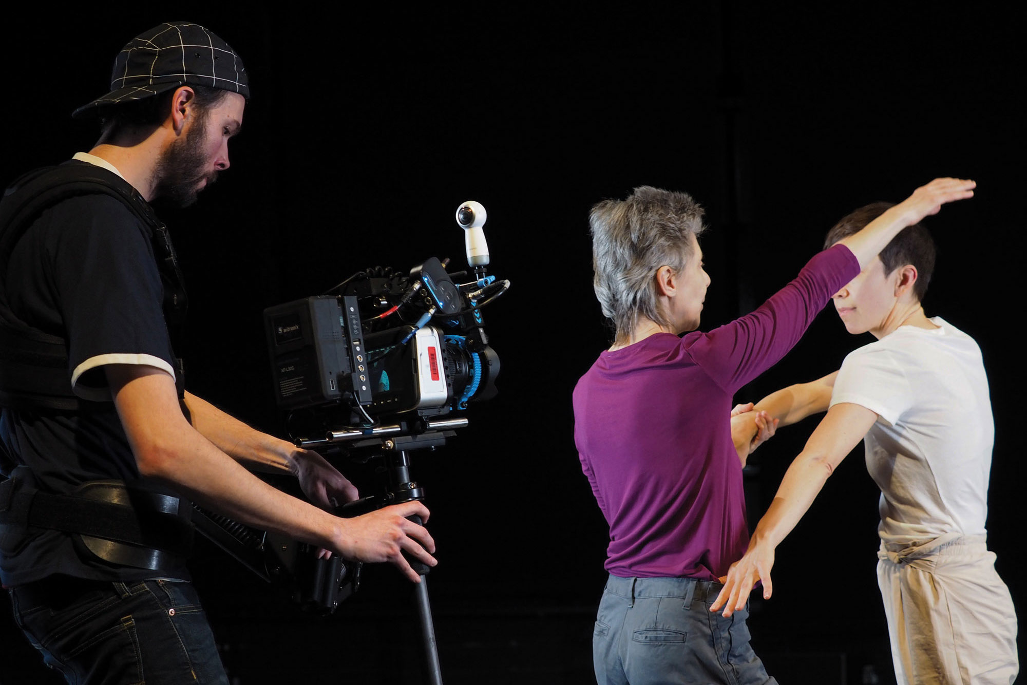 two dancers and a steadicam operator shooting in studio 1