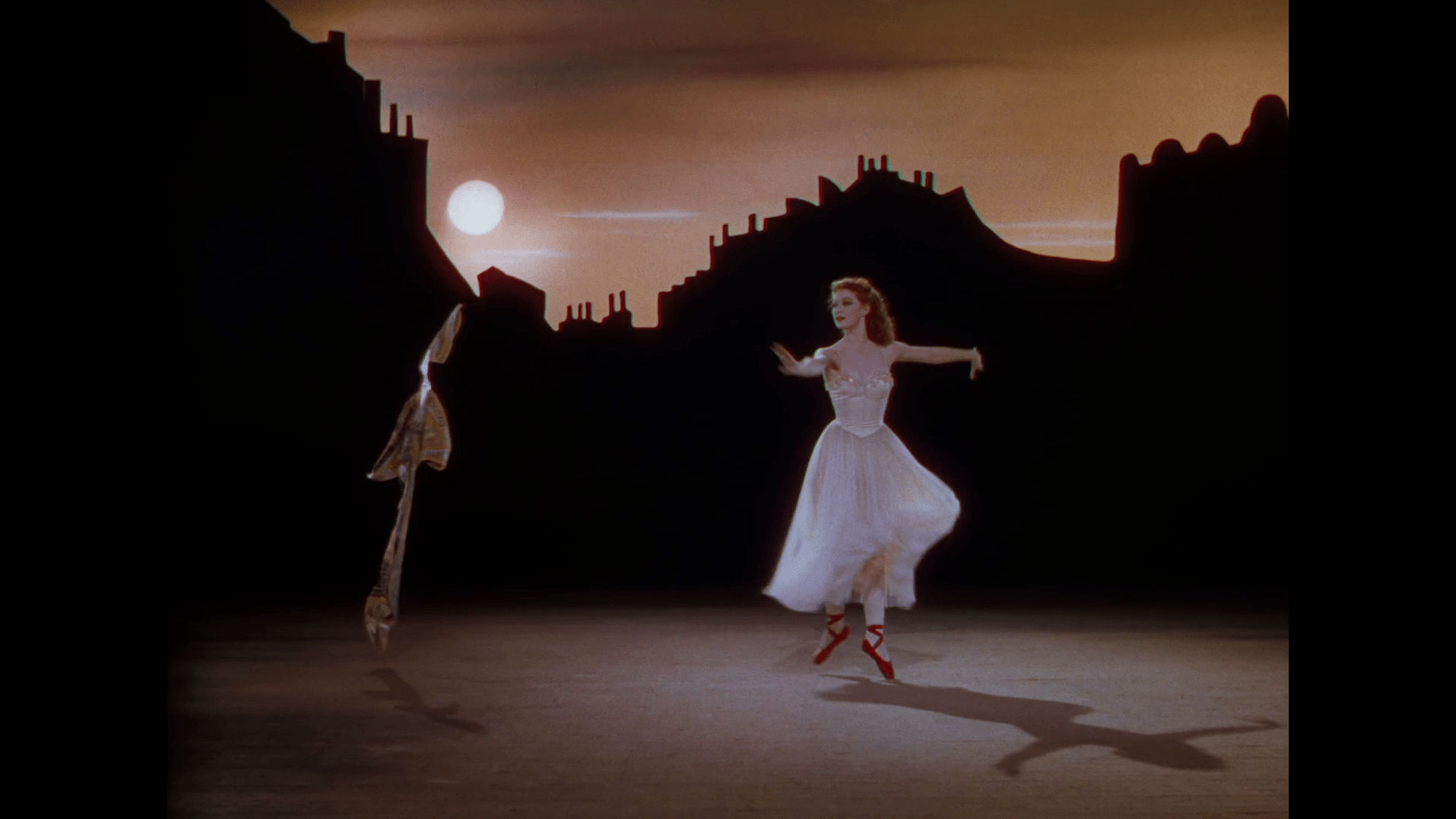 a woman in 40s attire dances with red shoes