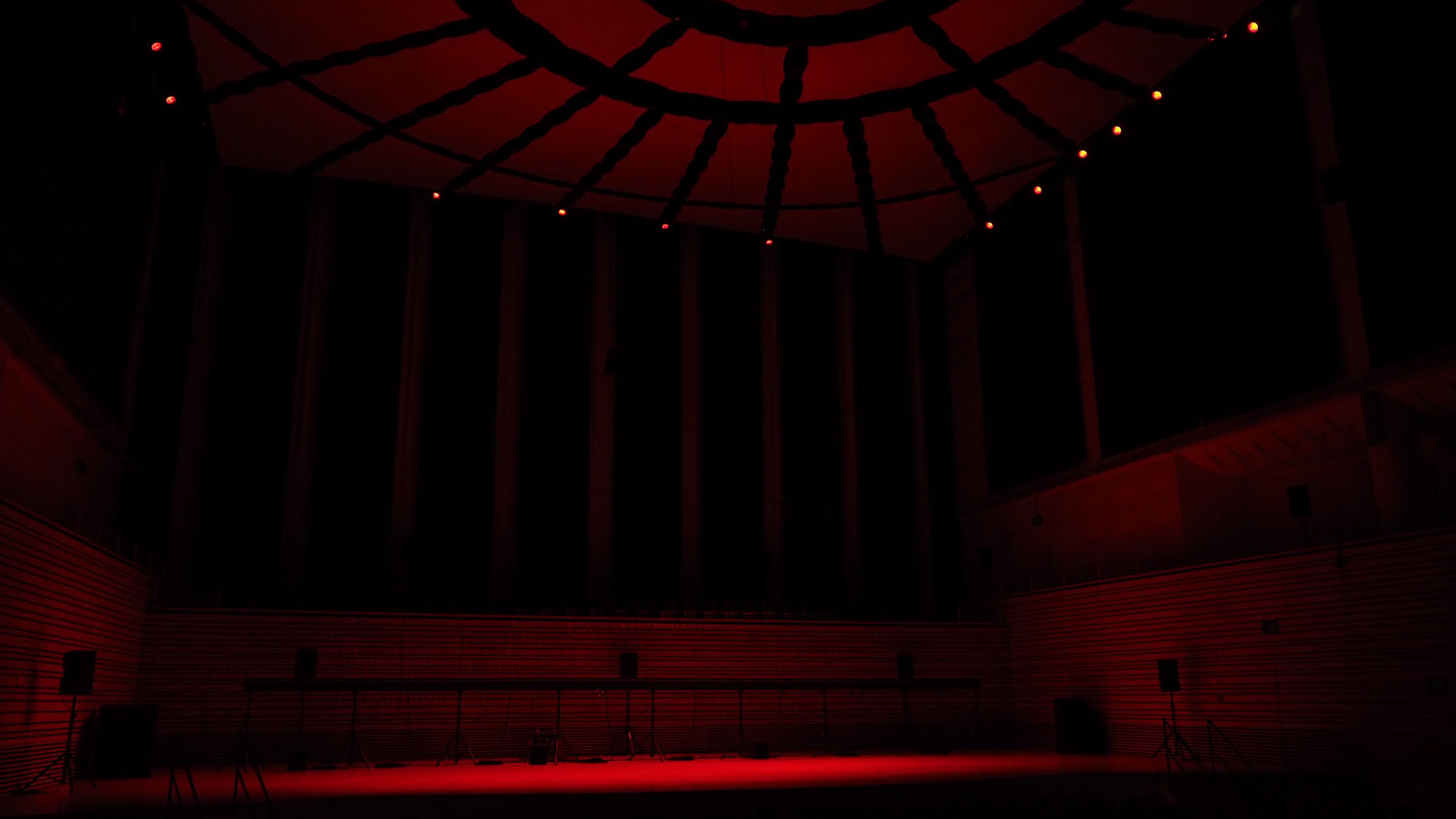 the concert hall bathed in deep red