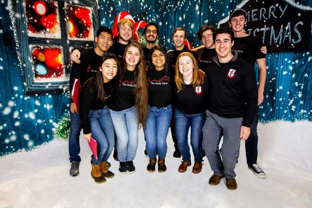 a group of students posing in a holiday scene.