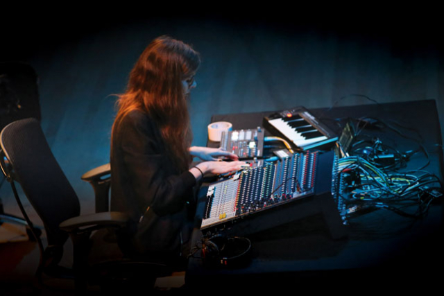 a woman at a sound console
