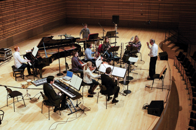 an ensemble on the stage of the concert hall