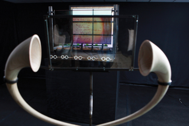 listening horns in front of a polarized glass