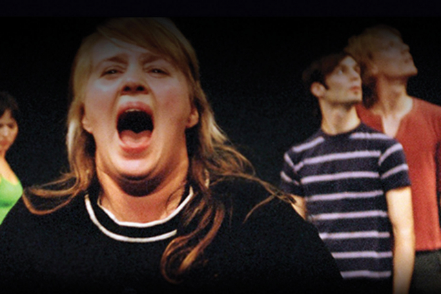 a woman screaming with 3 people in the background