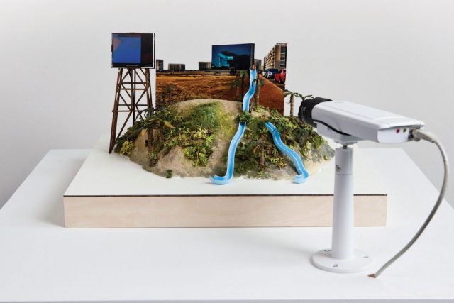 a model of a city with a cct camera pointing at it