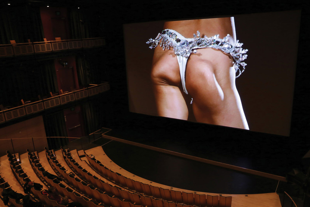 a wiggling set of buttocks on the big screen in the theater